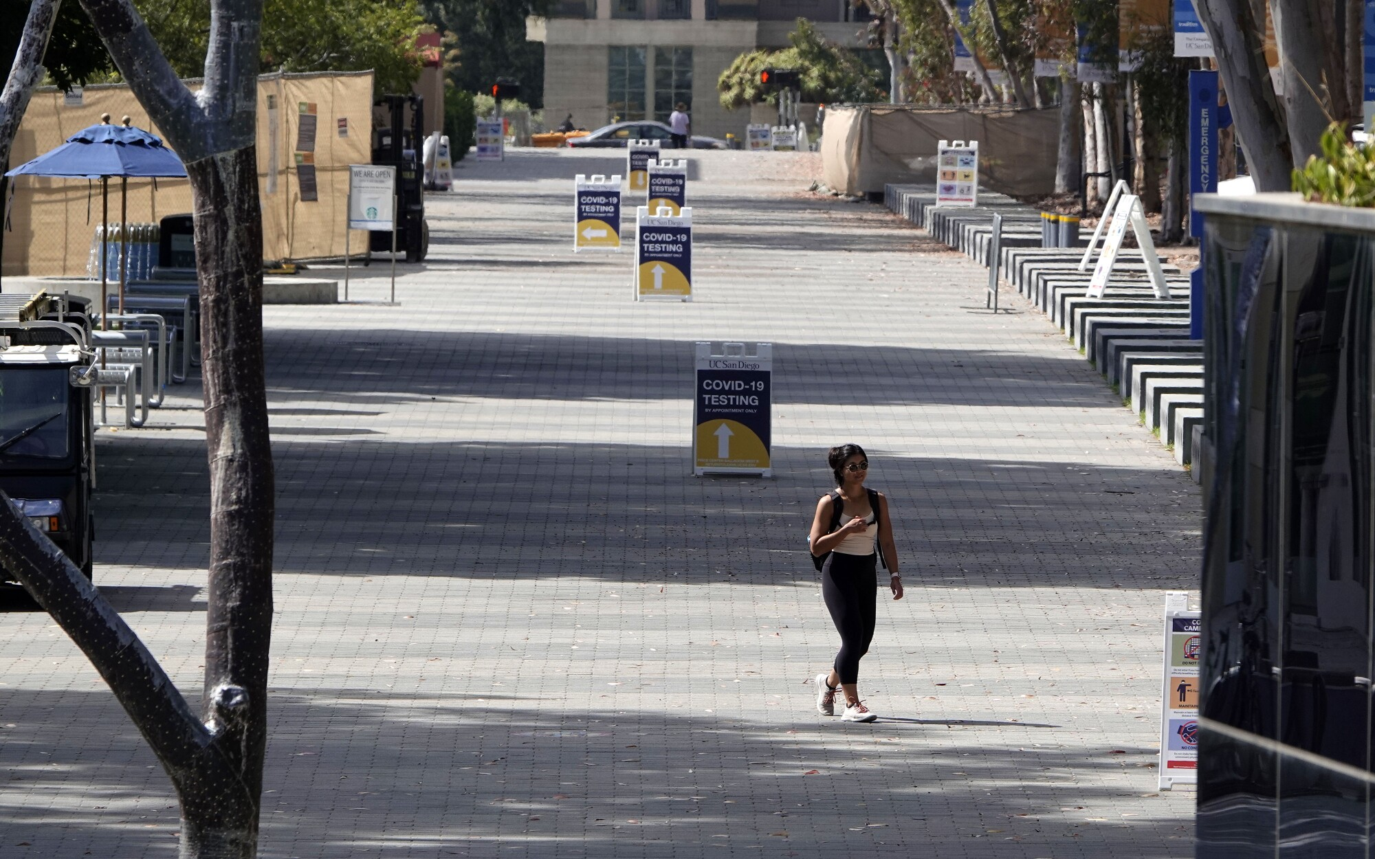 A lone student strolls along Library Walk at UC San Diego