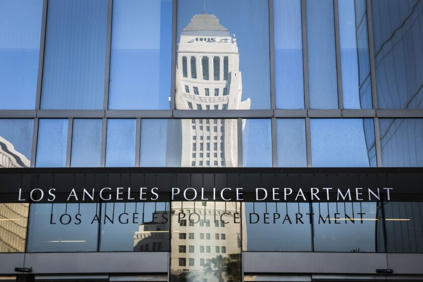 City Hall reflected on LAPD headquarters in downtown Los Angeles.