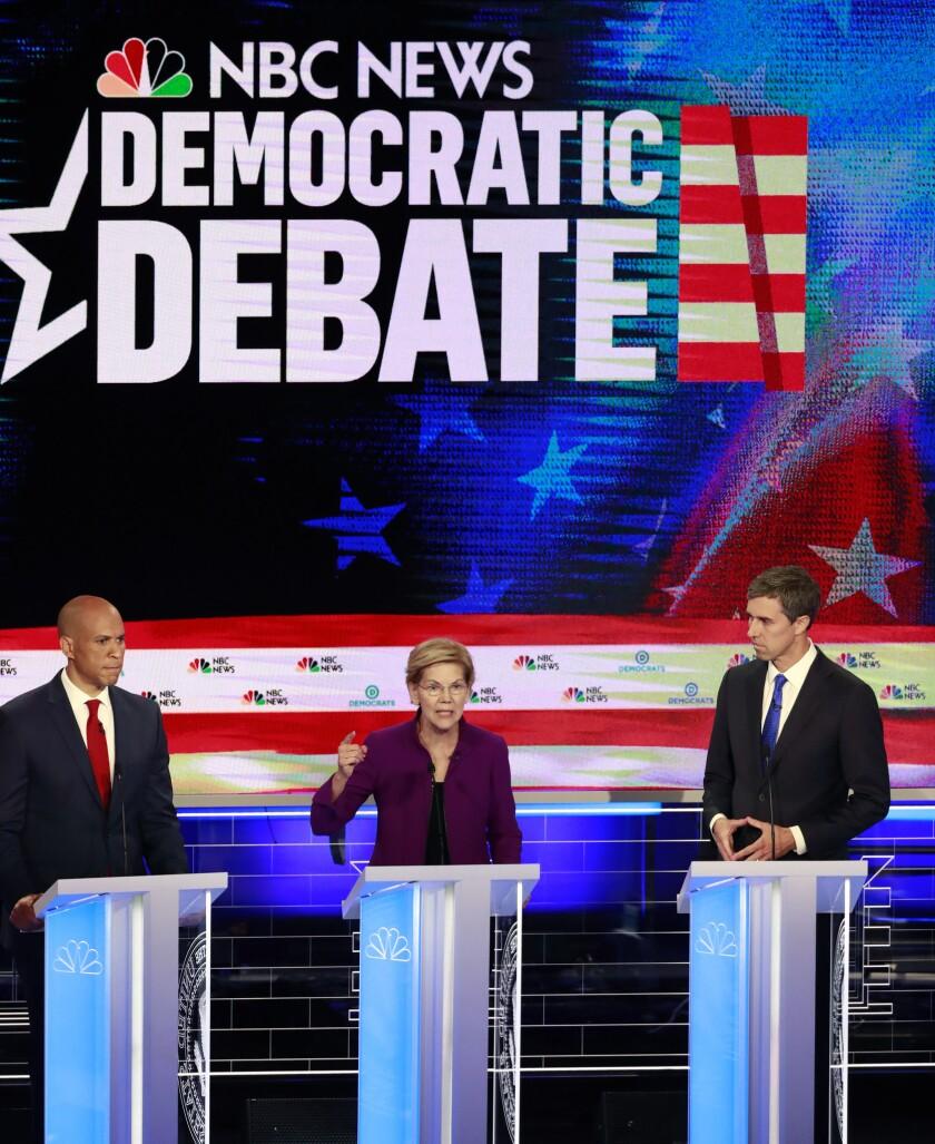 Democratic presidential candidate Massachusetts Sen. Elizabeth Warren, center, speaks during a Democ