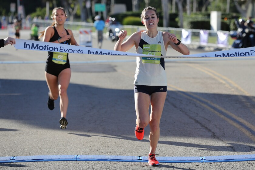Danae Dracht, of Los Angeles, wins the women's Tri-City Medical Center Carlsbad Half Marathon by a second ahead of Nicole Lane, of Sacramento, on Sunday. Dracht (1:16:39) improved her personal best by two seconds in a tune-up for this year's US Olympic Marathon Trials.
