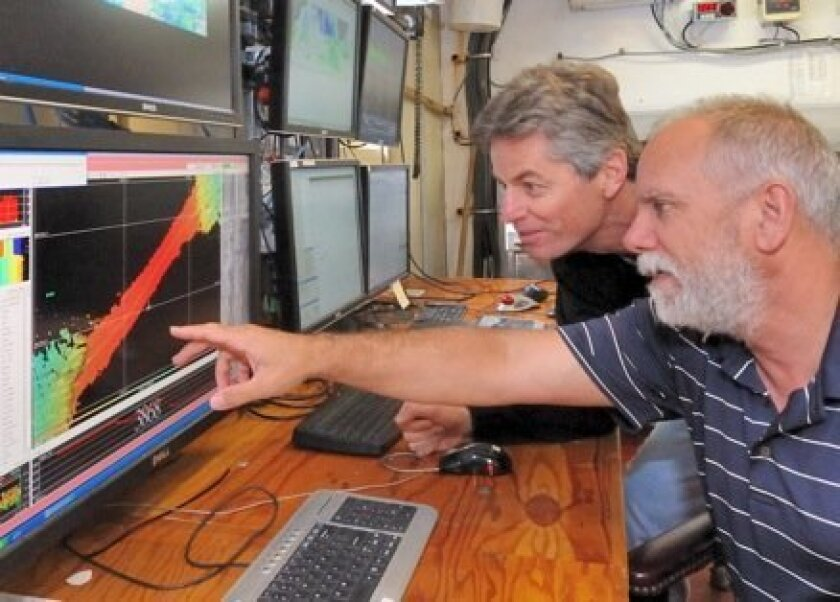 (Left to right) Chris Curl, captain of the R/V Melville, and geophysicist J.J. Becker.