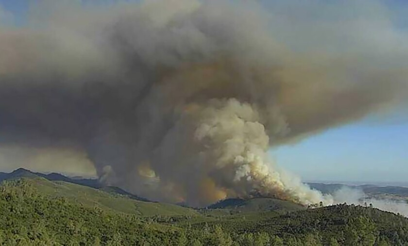 The Walker fire in an image from a remote camera near New Hogan Lake in Calaveras County on Tuesday.