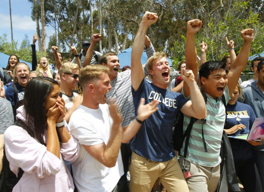 UC San Diego athletes celebrate after undergraduates voted to more than double student athletics fees to fund a move to NCAA Division I in sports.