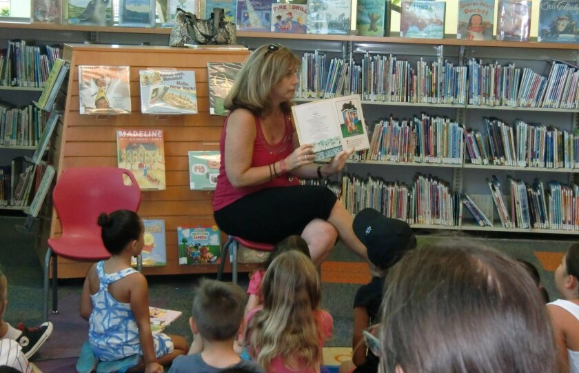 """Knob Hill Elementary teacher Cathy Haap reads """"Dog Breath"""" to children at the San Marcos library."""