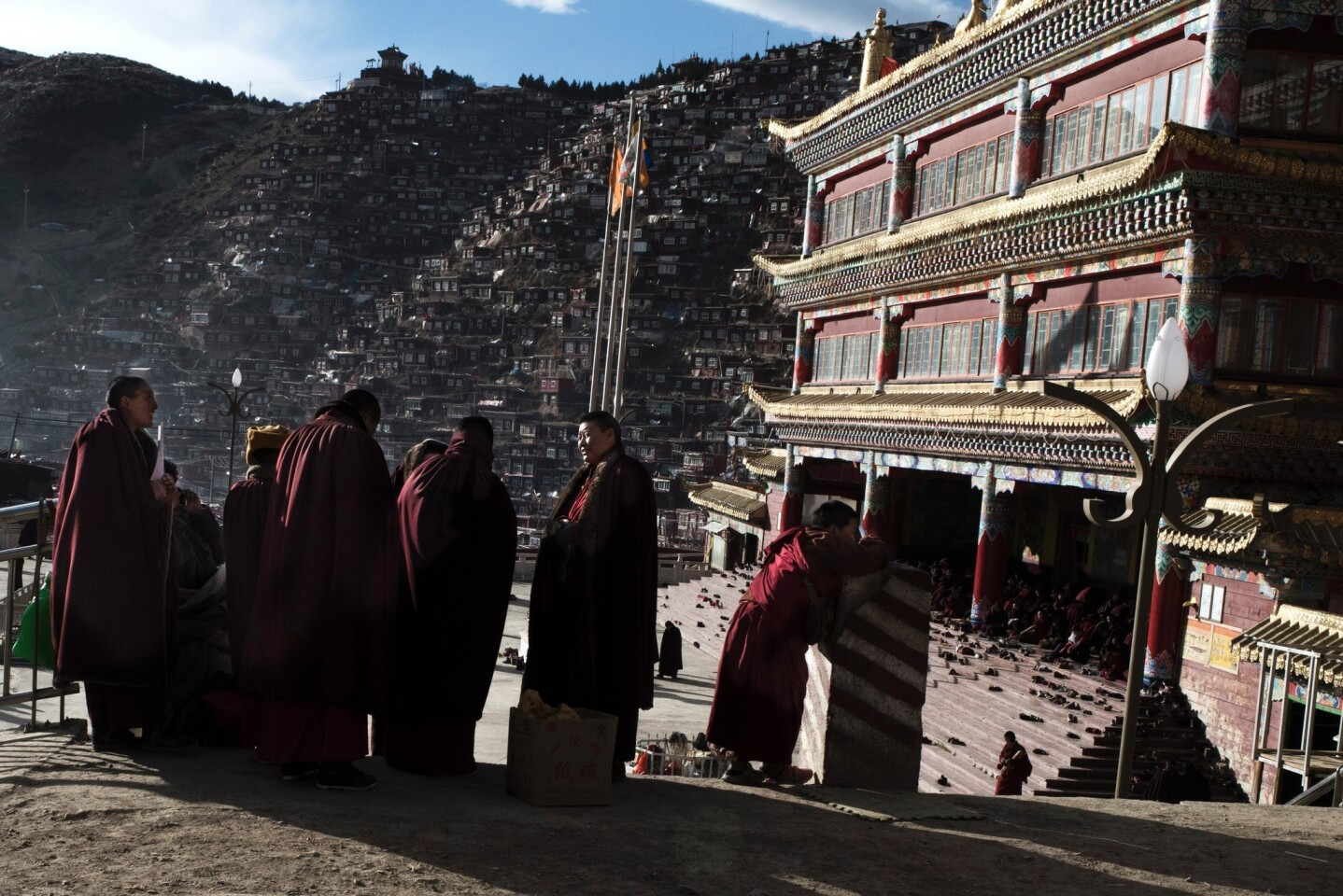 Buddhist nuns gather at the Larung Gar Buddhist Institute, where up to 40,000 monks and nuns are in residence for parts of the year. A notice from local officials began circulating in recent months saying that Larung Gar's population must be reduced to no more than 5,000 residents by Sept. 30.