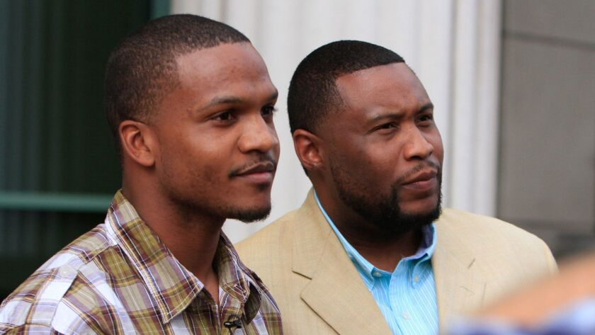 Brandon Duncan and Aaron Harvey at a 2015 news conference after murder charges were dismissed against them.
