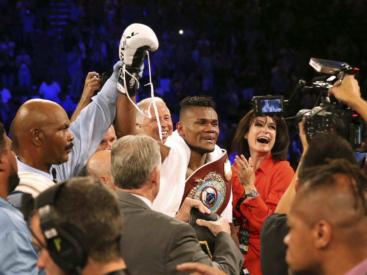 Eleider Alvarez, center, of Colombia, celebrates after he knocked out Sergey Kovalev, of Russia, in the seventh round of their boxing bout at 175 pounds, Saturday, Aug. 4, 2018, in Atlantic City, N.J.