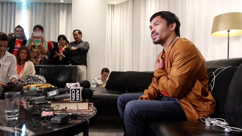 Manny Pacquiao speaks to the media about his hurt shoulder on Sunday in his Las Vegas hotel room.