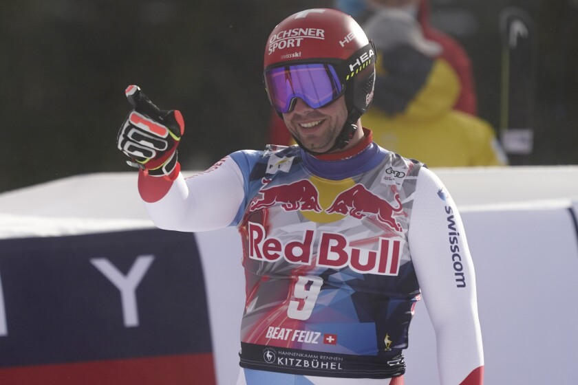 Switzerland's Beat Feuz gets to the finish area after completing an alpine ski, men's World Cup downhill, in Kitzbuehel, Austria, Sunday, Jan. 24, 2021. (AP Photo/Giovanni Auletta)