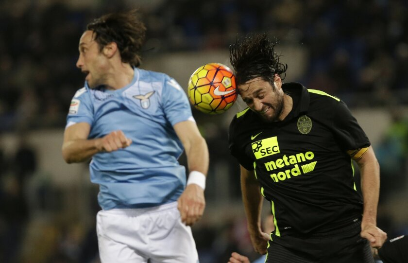 Hellas Verona's Luca Toni, right, heads the ball during a Serie A soccer match between Lazio and Hellas Verona  at Rome's Olympic stadium, Thursday, Feb. 11, 2016. (AP Photo/Alessandra Tarantino)