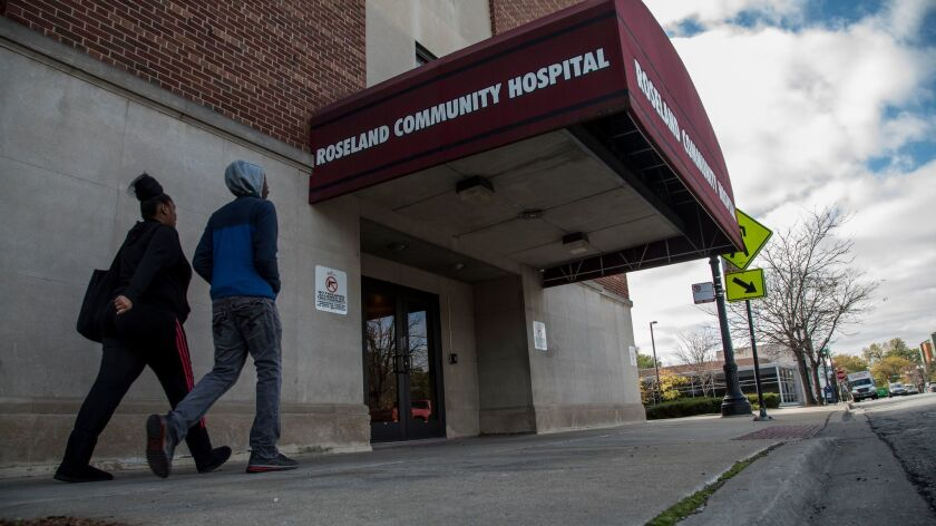 Roseland Community Hospital has laid off 35 employees and reduced the pay of all of its nonunion staff in an effort to cut costs at the South Side health facility.