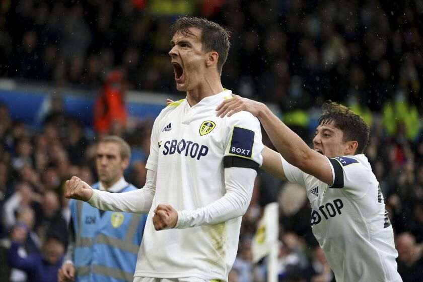 Leeds United's Diego Llorente celebrates scoring their side's first goal during the English Premier League soccer match between Leeds United and Watford at Elland Road, Leeds, England, Saturday Oct. 2, 2021. (Mike Egerton/PA via AP)