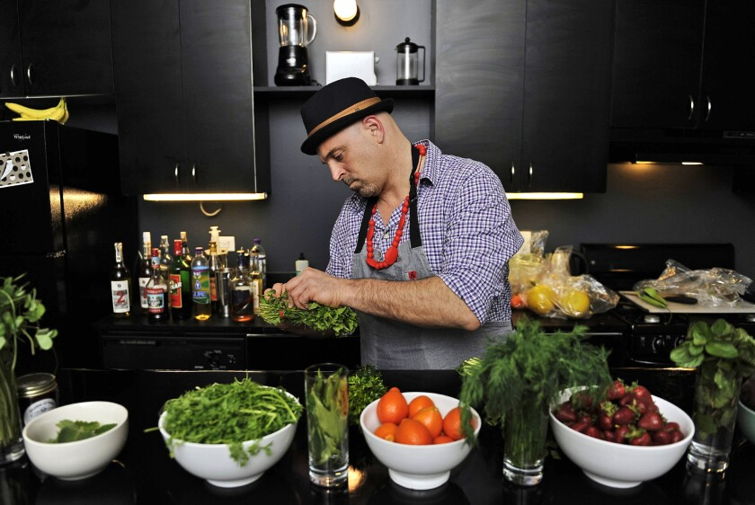 Matthew Biancaniello sets up an array of ingredients he will use to create his unique cocktails at a Feb. 28 event in downtown Los Angeles.