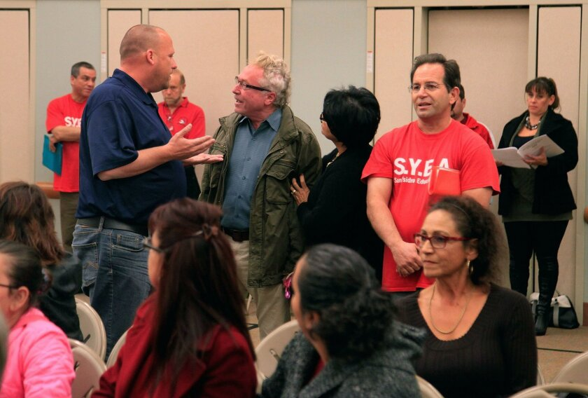 Discord continues in the San Ysidro School District Raymond Hallmen (left) and Jeff Scarlett (right) have a disagreement at the school board meeting Thursday. Police showed up after the incident.