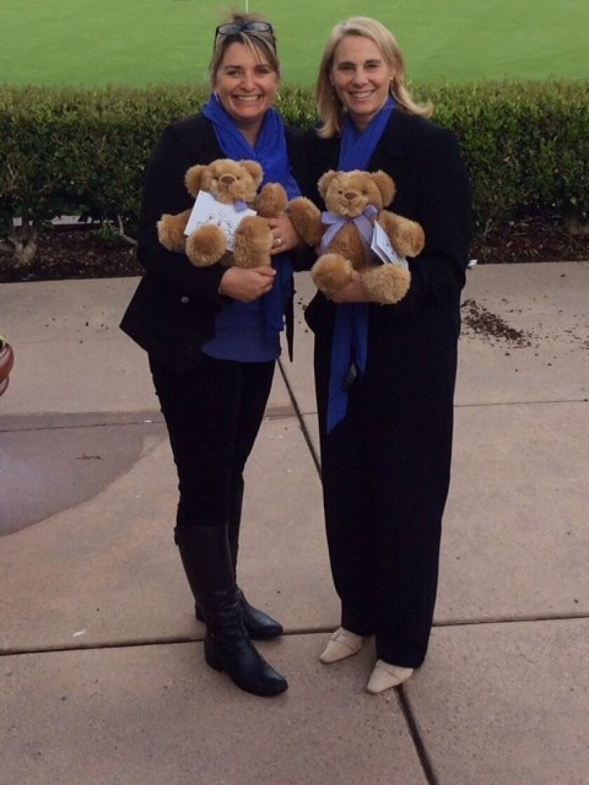 La Jolla High School graduates Marcella Johnson (nee Millot) and Susan Heck (nee Choisser) with their weighted teddy bears, called Comfort Cubs.