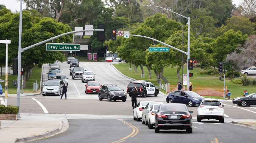 """Police direct traffic away from Southwestern College on Thursday after college police were told of a """"credible threat"""" of violence made by a student."""