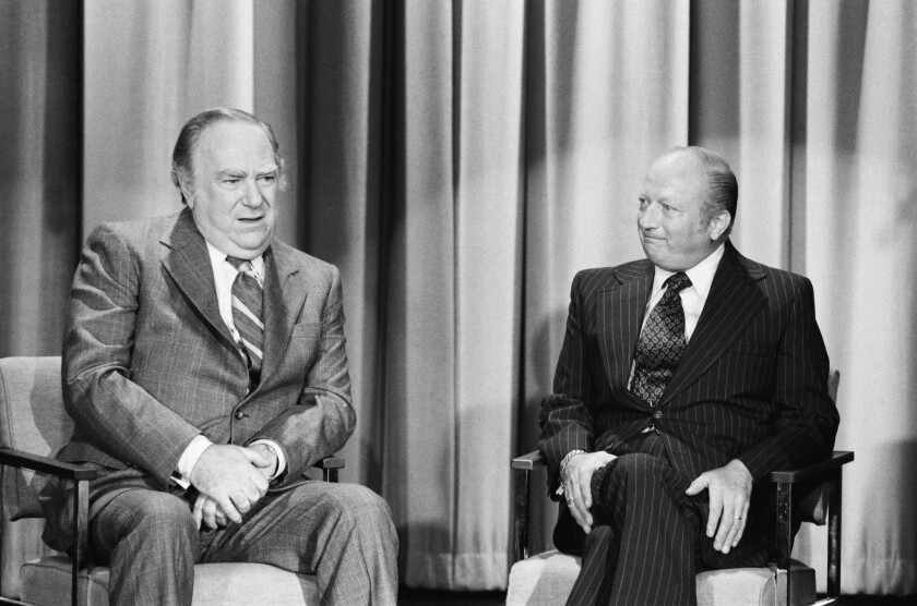 """Comedians Bob Elliott, right, and Ray Goulding are shown during a """"Tonight Show"""" appearance in 1976."""