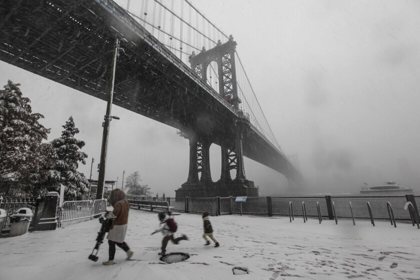 Snowfall descends on the Manhattan Bridge in Brooklyn on Thursday, November 15, 2018.