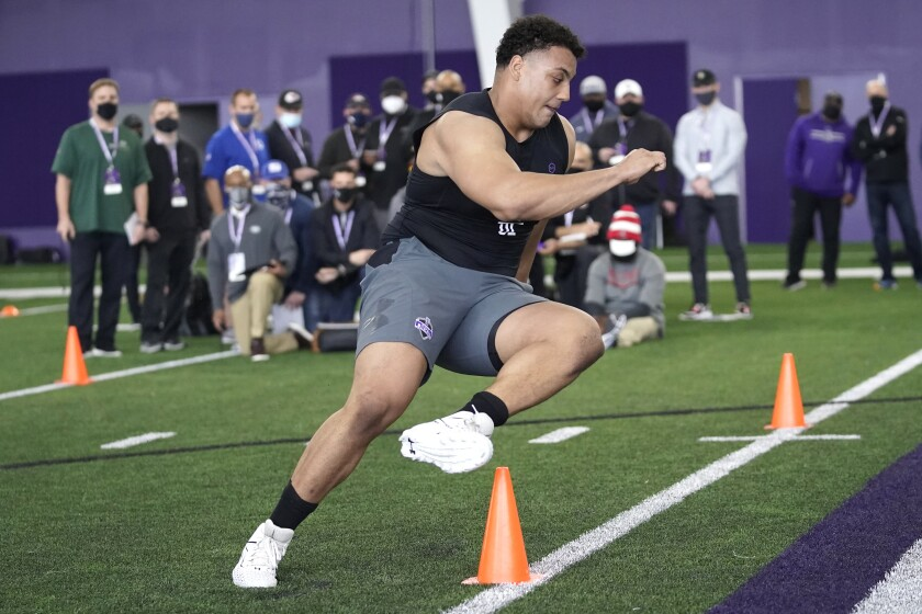 Northwestern offensive lineman Rashawn Slater, participates in school's Pro Day football workout for NFL scouts on March 9.