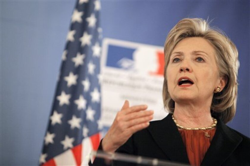 U.S. Secretary of State Hillary Rodham Clinton gestures during a join press conference with French Foreign Minister Bernard Kouchner, unseen, at the Quai d'Orsay, in Paris, Friday Jan. 29, 2010. (AP Photo/Thibault Camus)