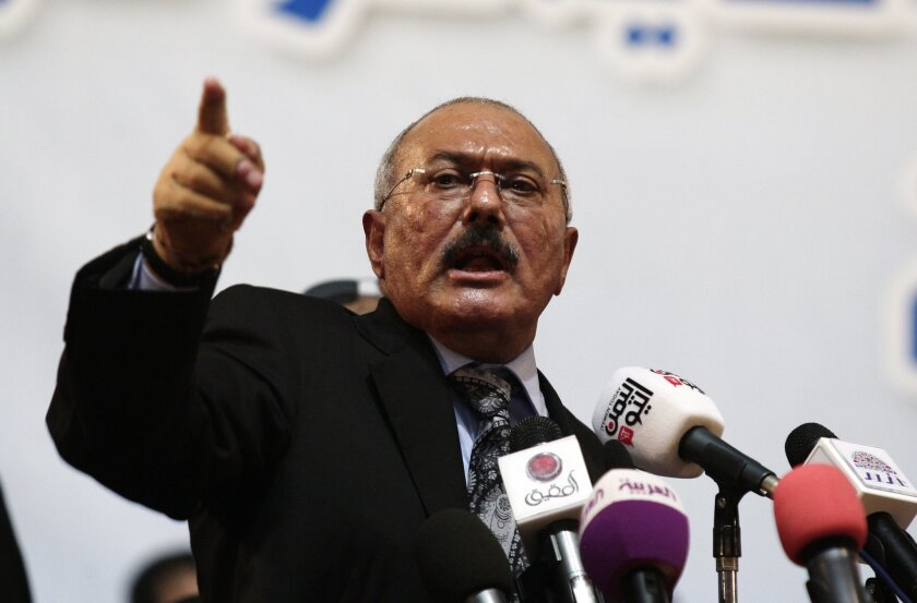 FILE - In a Sept. 3, 2012 file photo, former Yemen's President Ali Abdullah Saleh speaks during a ceremony marking the 30th anniversary of his General People's Congress party (GPC) establishment in Sanaa, Yemen. U.N. experts said in a report circulated Wednesday, Feb. 25, 2015, that Yemen's former president Ali Abdullah Saleh is alleged to have amassed assets worth between $32 billion and $60 billion, most believed to have been transferred abroad under other names. (AP Photo/Hani Mohammed, File)