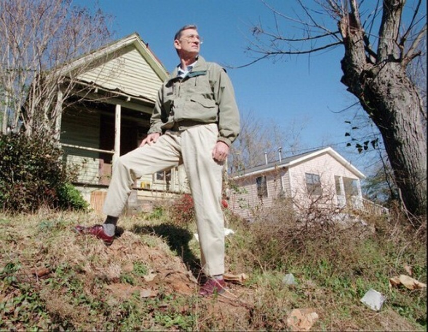 Self-made millionaire Millard Fuller and his wife, Linda, gave away their wealth and spent decades helping to organize and construct affordable housing for the poor. Under Fuller's leadership, Habitat for Humanity volunteers, including former President Carter, built more than 175,000 homes in 100 countries. He died Tuesday at age 74.