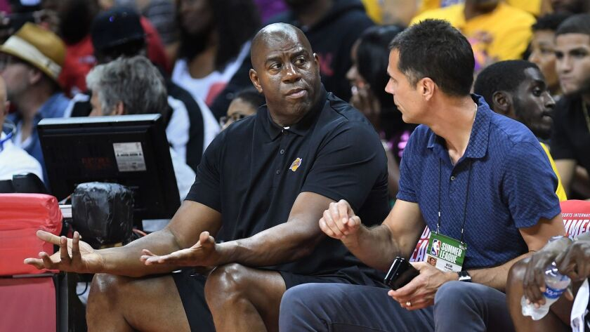 LAS VEGAS, NEVADA JULY 7, 2017-Lakers Magic Johnson and Rob Pelinka sit courtside at the first NBA S