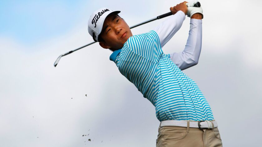 Michael Kim tees off on the Torrey Pines north course during the first round of the Farmers Insurance Open on January 25, 2018.