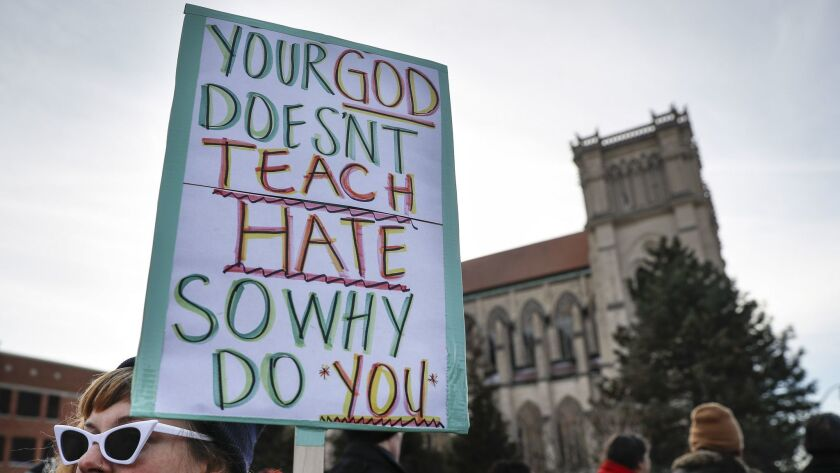 Protestors gather outside the Catholic Diocese of Covington Tuesday, Jan. 22, 2019, in Covington, Ky