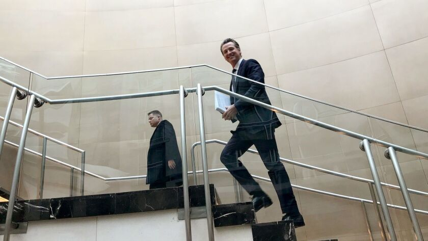 WASHINGTON DC FEBRUARY 24, 2019 -- California Gov. Gavin Newsom races between meetings at the Natio