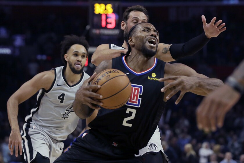 Clippers forward Kawhi Leonard drives to the basket during the second half of a game against he Spurs at Staples Center.