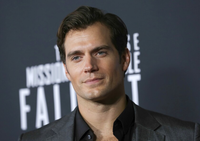 """FILE - In this July 22, 2018 file photo, actor Henry Cavill attends the U.S. premiere of """"Mission: Impossible - Fallout"""" in Washington. Cavill dons a long white wig to play monster hunter Geralt of Rivia in """"The Witcher,"""" an ambitious eight-episode adaptation of Polish author Andrzej Kapowski's books. The show premieres on Netflix on Dec. 20. (Photo by Brent N. Clarke/Invision/AP, File)"""