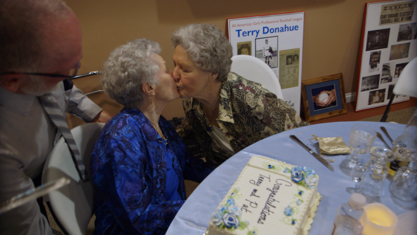 Terry Donahue and Pat Henschel kiss at their wedding in the documentary 'A Secret Love'