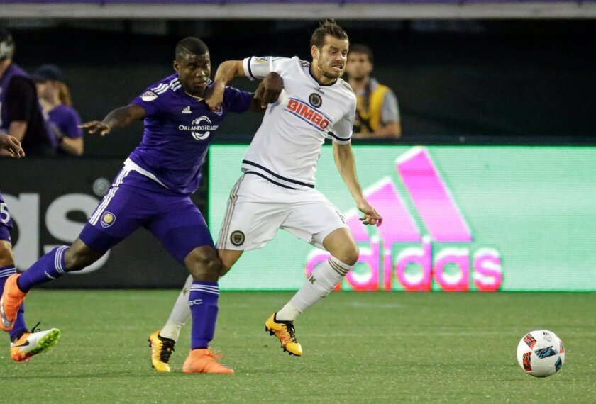 Orlando City's Carlos Rivas, left, goes against Philadelphia Union's Tranquillo Barnetta for the ball during the first half of an MLS soccer game, Wednesday, May 25, 2016, in Orlando, Fla. (AP Photo/John Raoux)