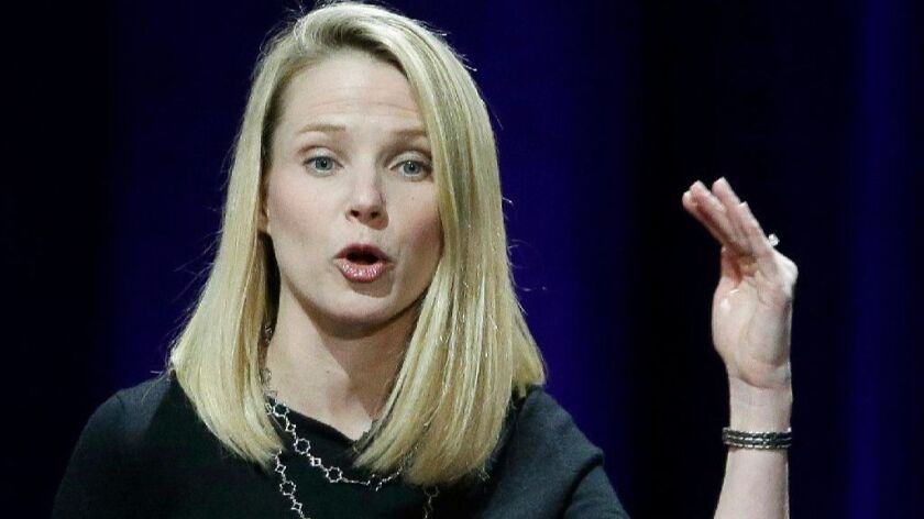 FILE - In this Feb. 19, 2015, file photo, Yahoo President and CEO Marissa Mayer delivers the keynote