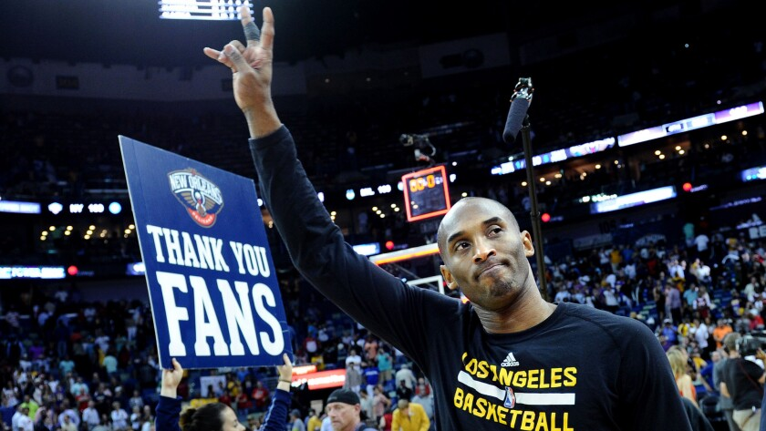 Kobe Bryant waves goodbye to fans as the Lakers leave the court following their loss to the Pelicans on Friday night in New Orleans.
