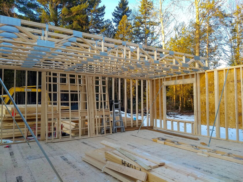 You're looking at magnificent floor trusses. These are spanning 28 feet, but you can go greater distances with ease. There's no need for a bearing wall or beam under them to support the weight of the floor above.