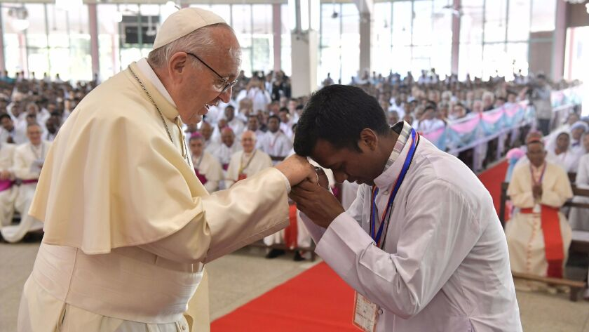 Pope Francis is greeted during his meeting Saturday with Bangladeshi prelates in Dhaka.