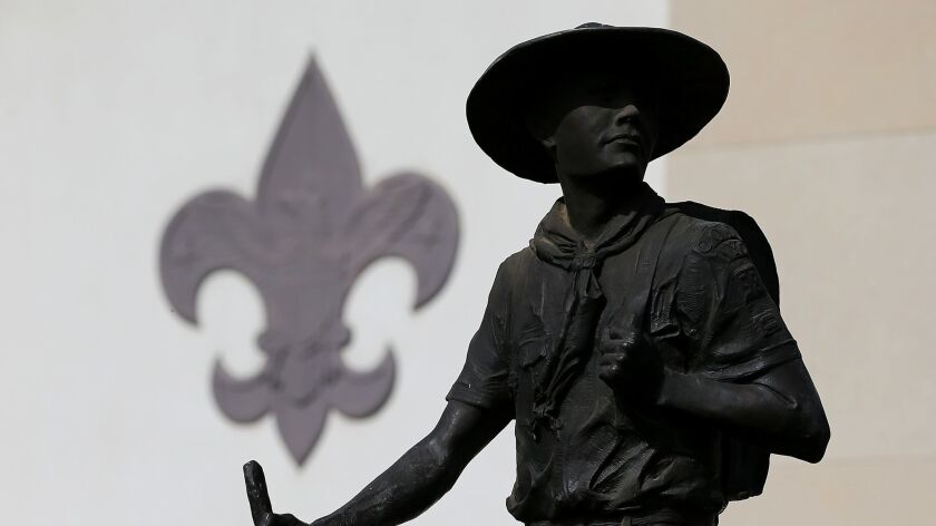 A 2013 file photo of a statue outside the National Scouting Museum in Irving, Texas. The Boy Scouts of America is now allowing girls to participate in Cub Scouts and to earn the rank of Eagle Scout.