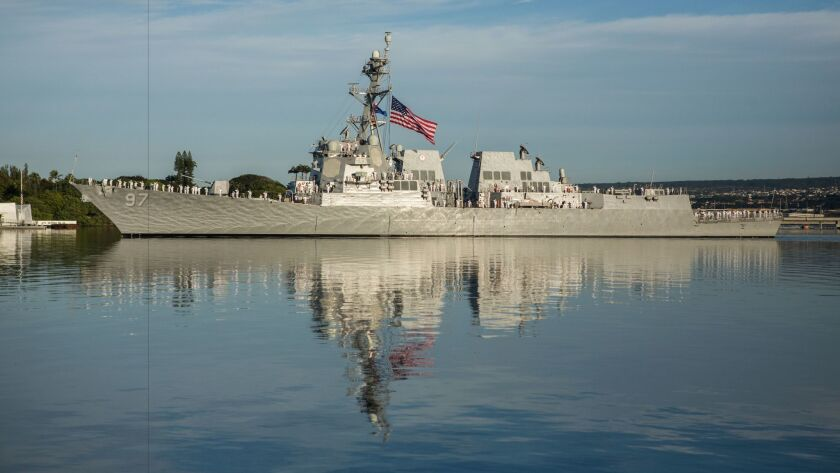 The U.S. Navy guided-missile destroyer Halsey conducts a pass-in-review during the 75th Anniversary National Pearl Harbor Remembrance Day Commemoration at Joint Base Pearl Harbor-Hickam, Hawaii, Dec. 7, 2016.