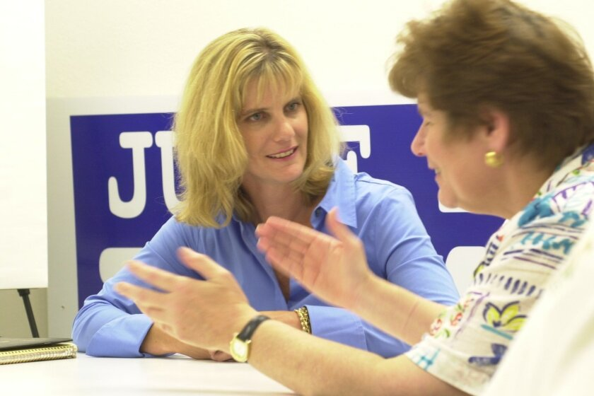 Consultant Jen Tierney, left, with Dumanis. [Union-Tribune file]