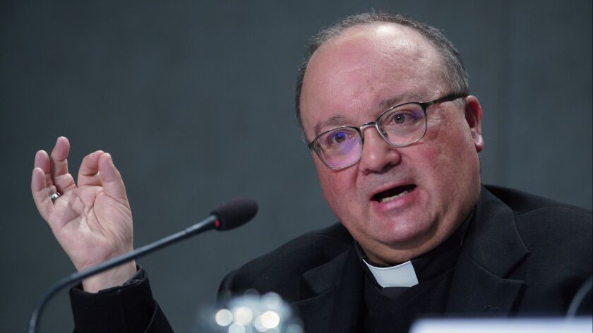 Malta's Archbishop Charles Scicluna talks to journalists during a press conference to present the ne