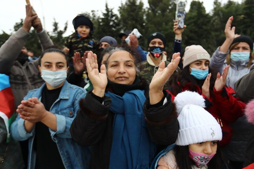 People in Baku, Azerbaijan, clap and cheer