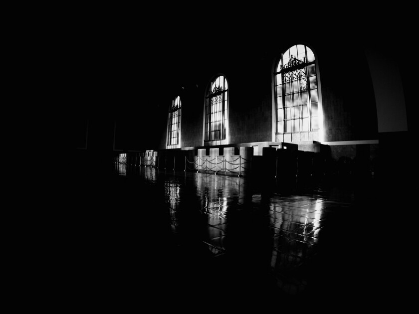 Light shines in through the windows in the old ticketing area at Union Station in downtown Los Angeles.