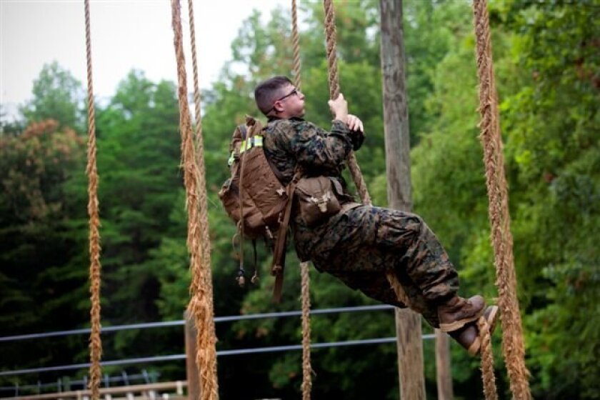 b453aa7dbc474 After failing on several attempts to reach the top of the obstacle course  rope climb