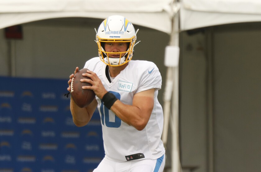 Chargers quarterback Justin Herbert looks to pass in practice.