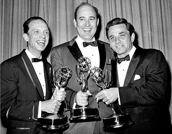 """Writer Carl Reiner, center, poses with actors Don Knotts, left, and Peter Falk as they hold their statuettes at the Emmy awards in Hollywood, in 1962. Falk was cited for outstanding single performance by an actor in a leading role in """"The Dick Powell Show, The Price of Tomatoes."""""""