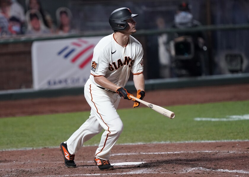 San Francisco Giants' Alex Dickerson watches his solo home run against the Colorado Rockies during the seventh inning of a baseball game on Monday, Sept. 21, 2020, in San Francisco. (AP Photo/Tony Avelar)