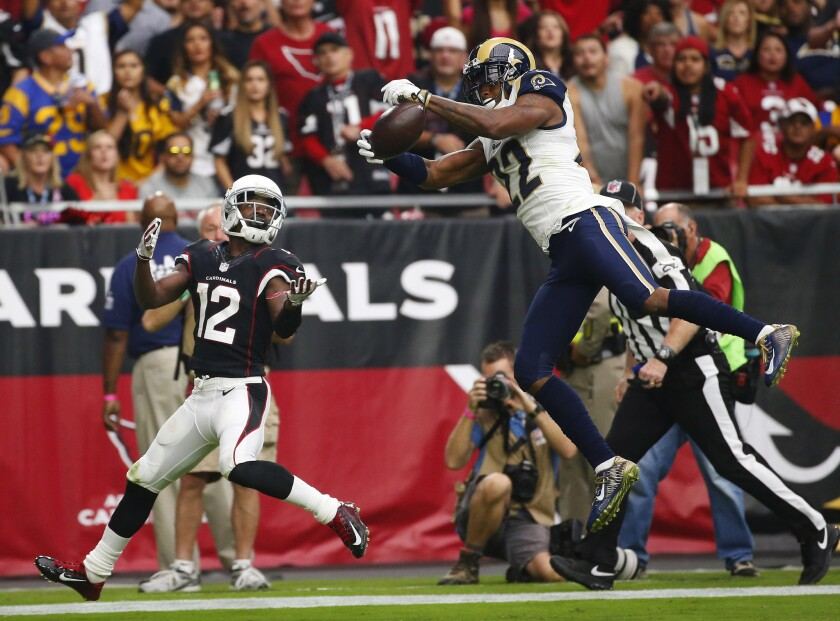 Rams cornerback Trumaine Johnson, right, intercepts a pass intended for Arizona Cardinals wide receiver John Brown during a game Oct. 2.