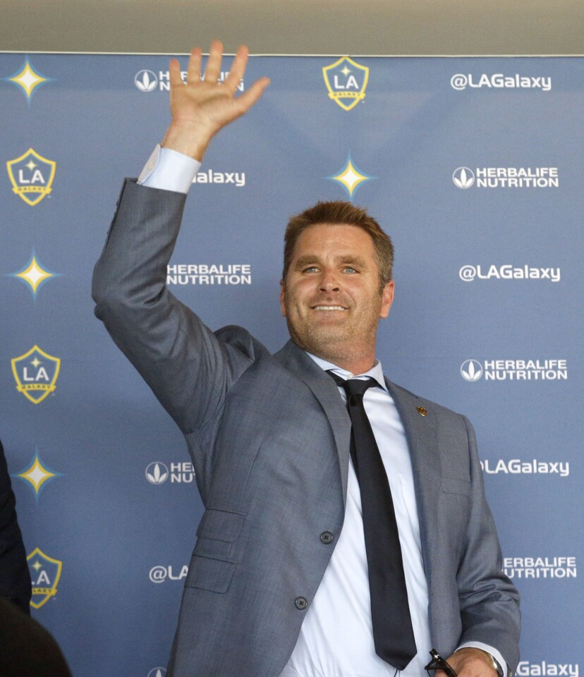 Curt Onalfo smiles as he is introduced as the new head coach of the Los Angeles Galaxy soccer team at news conference in Carson, Calif., Tuesday, Dec. 13, 2016. Onalfo replaces Bruce Arena, who returned to the U.S. national team after guiding the Los Angeles Galaxy to three MLS Cup titles. (AP Photo/Nick Ut)